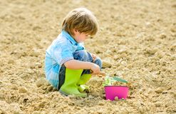 Earth day. soils and fertilizers. summer farm. ecology and environmental protection. happy child gardener. spring. Country side village. small kid planting a stock photography