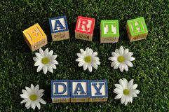Earth day spelled with colorful alphabet blocks Royalty Free Stock Images