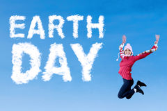 Earth Day word with woman wears sweater Royalty Free Stock Image