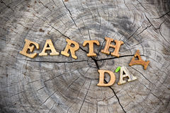 Earth day word on wood background Royalty Free Stock Photos