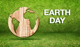 Earth day word with wood world globe icon at green grass room,Ec Royalty Free Stock Photography