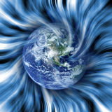 Earth does a twirl in space. Collage - Earth and drawing twirl atmosphere Stock Photo