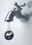 Earth drop. 3d computer generated image of a faucet with a drop with an earth inside Stock Photo
