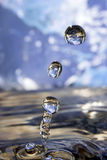 Earth in drop of water. Stock Images