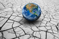 The earth on dry ground. Elements of this image furnished by NAS Royalty Free Stock Images