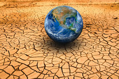 The earth on dry ground. Elements of this image furnished by NAS Royalty Free Stock Photos