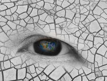 The earth in eldery women eye ,including elements furnished by N Royalty Free Stock Image
