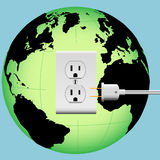 EARTH electric plug outlet Energy Globe. ENERGIZE EARTH with an electric plug in an outlet in an Energy Globe Royalty Free Stock Image