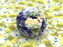 Earth among Euro banknotes. As symbol for globel finance Stock Photography