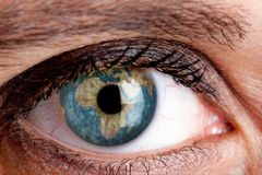 Earth eye. Eye with the earth inside Royalty Free Stock Photos