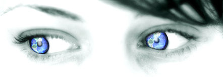 Earth Eyes - 01. A woman with the eyes of the Earth. Here beautiful translucent blue eyes reflect the planet Earth Stock Photography