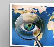 Earth Eyes. Portrait of a woman with the map of the world painted on her face and a magnifying glass Stock Images