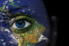 Earth face. Earth painted on face with blue eye Stock Photography