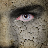 Earth face. Cracked earth texture on angry man face Royalty Free Stock Photos