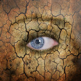 Earth face. Woman face with cracked brown earth pattern Stock Photography