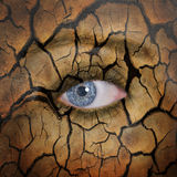 Earth face. Woman face with cracked brown earth pattern Royalty Free Stock Images