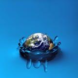 Earth falling in water Stock Photos