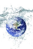 Earth falling in water. Litlle Earth falling in water Stock Photography