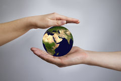 The Earth in a female and male hands Royalty Free Stock Photo