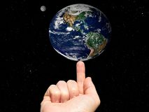 Earth on finger Stock Image