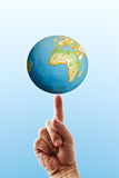 The earth on a finger Royalty Free Stock Photography