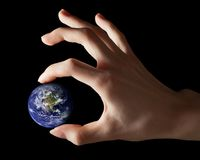 Earth between fingers Royalty Free Stock Image