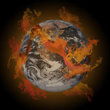 Earth on fire. A large crack on the earth with fire Royalty Free Stock Photos