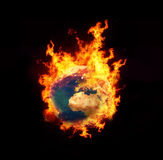 Earth on fire. In black background Stock Photos