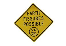 Earth fissures possible street sign royalty free stock image