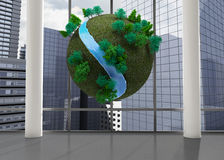 Earth floating in front of cityscape Stock Photos
