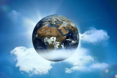 Earth floating in the sky Royalty Free Stock Photos