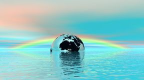 Earth floating in water with rainbow behind Royalty Free Stock Photography