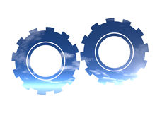 Earth Friendly Industry. Two Similar Cogwheels Set Against Clouds In The Sky Stock Image
