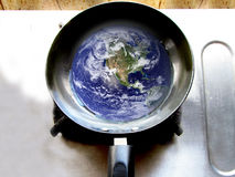 Earth in frying pan showing global warming. Its photo, depicting issue of global warming vector illustration