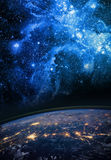 Earth and galaxy. Elements of this image furnished by NASA. Stock Photo
