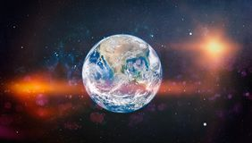 Earth, galaxy and sun. Elements of this image furnished by NASA. Royalty Free Stock Image