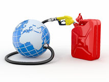 Earth, gas pump nozzle and canister Royalty Free Stock Image