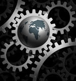 Earth gear. The earth  into a gear mechanism Royalty Free Stock Images