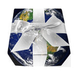 Earth Gift. The earth wrapped in a gift box Stock Images