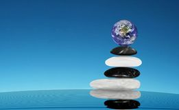 Earth planet, global world blance.. Earth planet is balancing on a stack of stones on the blue sky and waiving water. The left part of picture is free for your Stock Photos
