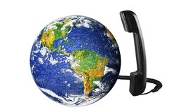 Earth globe. Phone with Earth globe close up Stock Photos