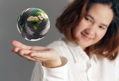 The earth globe. In hand Royalty Free Stock Image