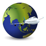 Earth globe and airplane Royalty Free Stock Photo