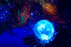 Earth globe America with Christmas background blue. Is dominant Stock Image