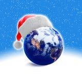 Earth Globe And Santa Hat Stock Photos