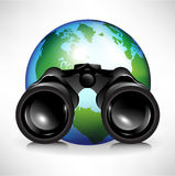 Earth globe with binoculars Royalty Free Stock Images