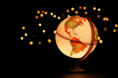 Earth globe on black. Earth over America represented by glowing desk globe in starry black sky Stock Photography