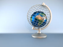 Earth globe in captivity. Earth globe captive in a wired globe - 3d render. Texture map comes from http://www.shadedrelief.com Royalty Free Stock Image