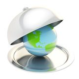 Earth globe on ceramic salver under a chrome food cover Royalty Free Stock Images