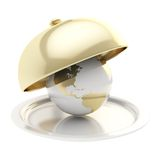 Earth globe on ceramic salver under a golden food cover Stock Photography